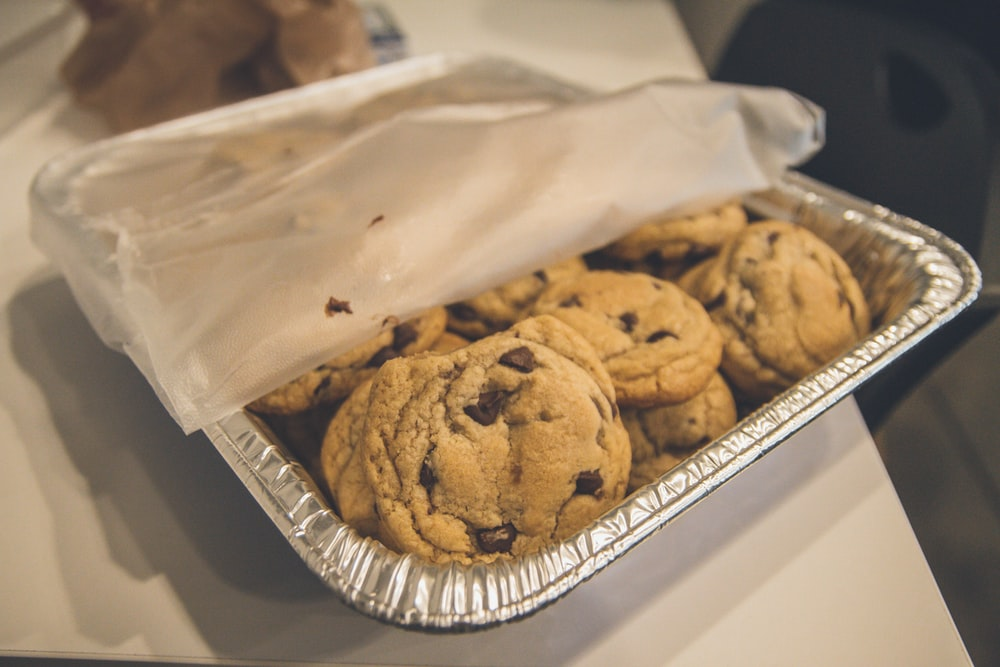shallow focus photo of cookies on gray tray