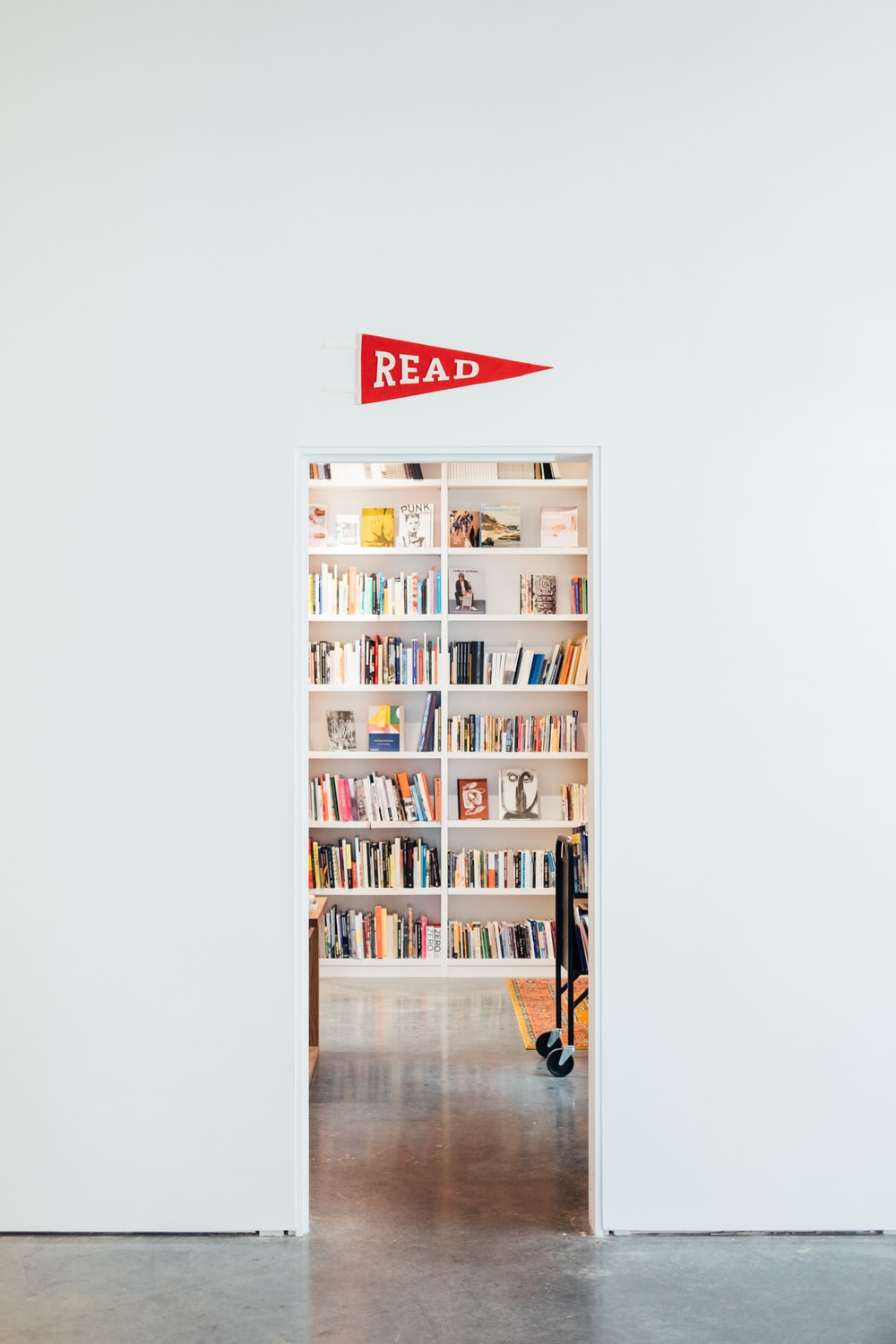 white wooden shelf with assorted books
