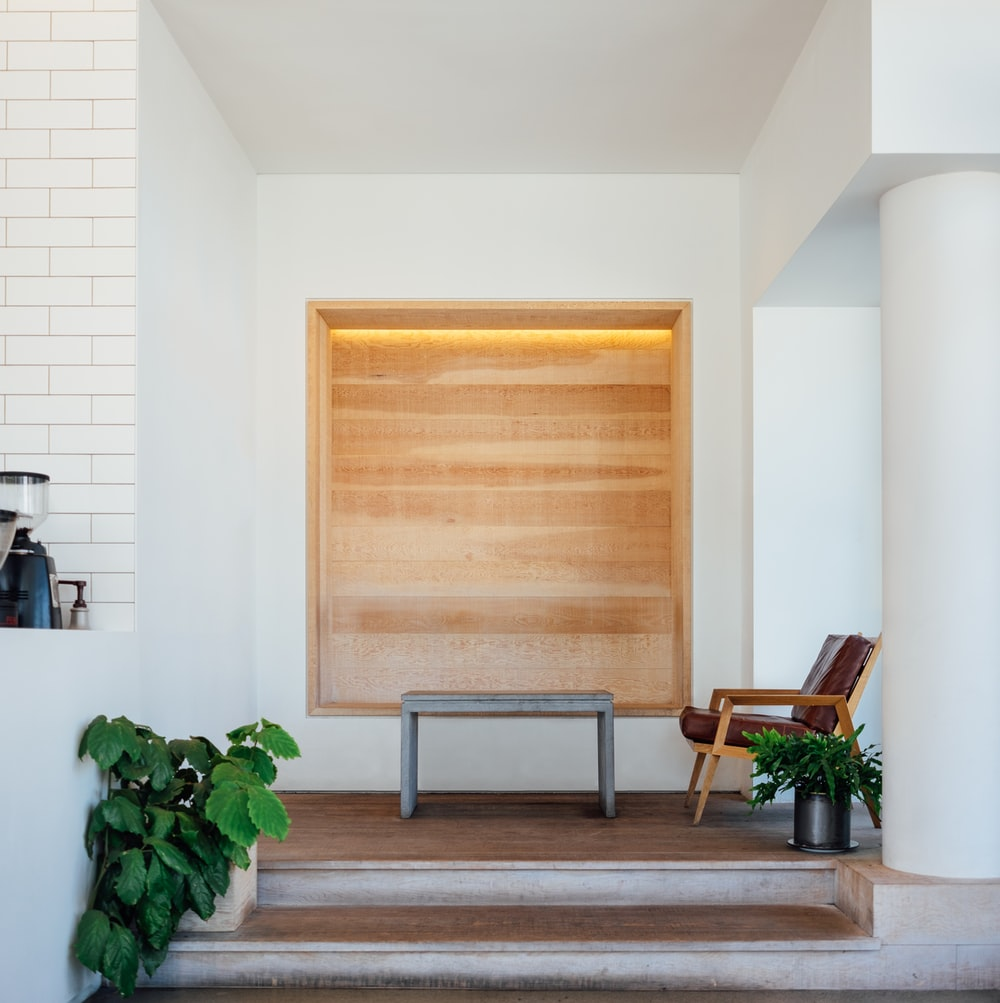 brown wooden board on white wall