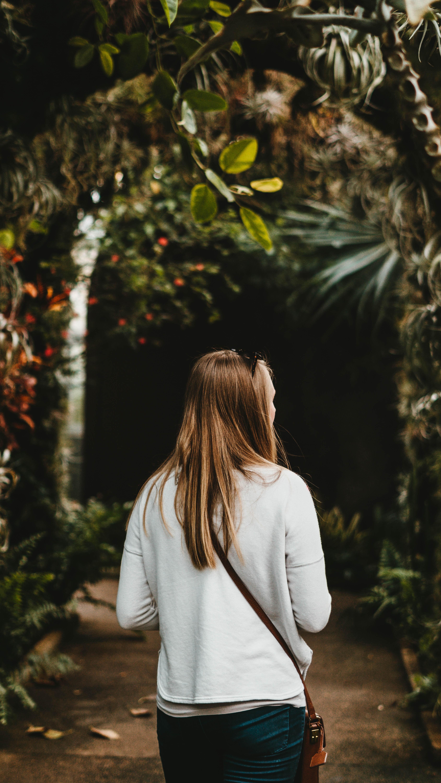 woman walking in brown garden