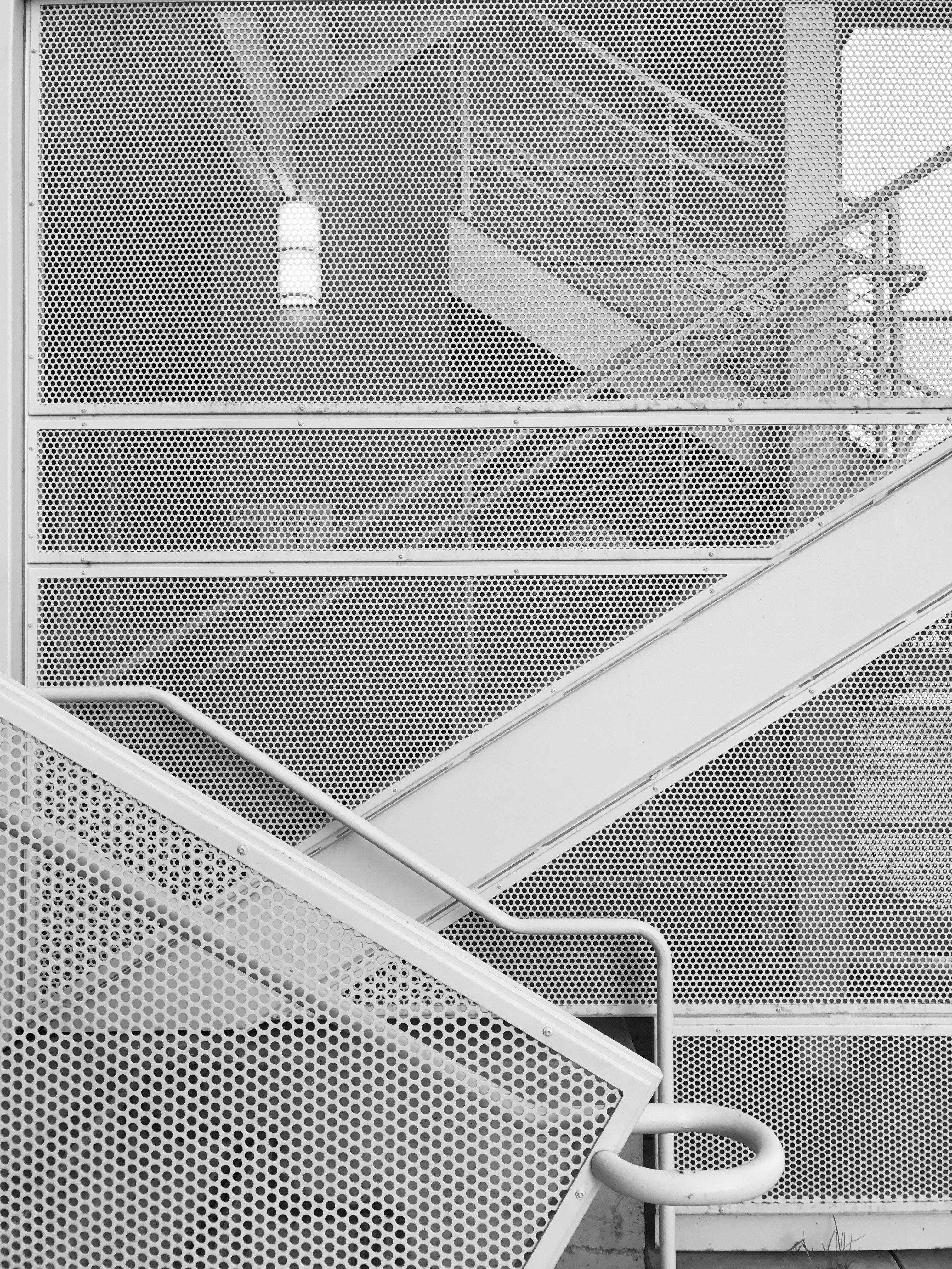 white metal stair at daytime