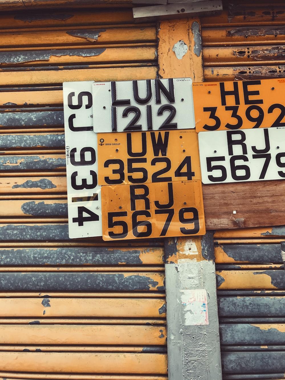 assorted license plates hanging on roller shutter