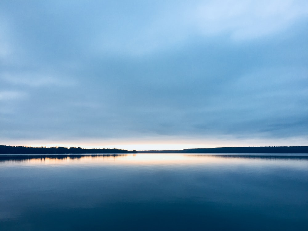 wide lake over sunset view