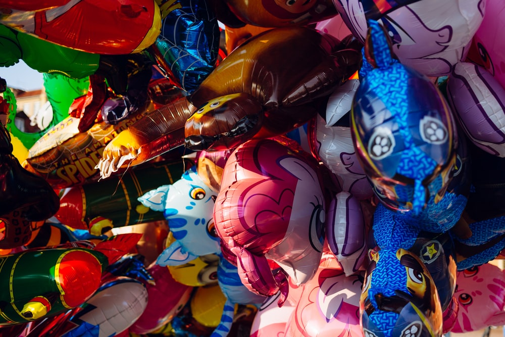 assorted-color inflatable balloons at daytime