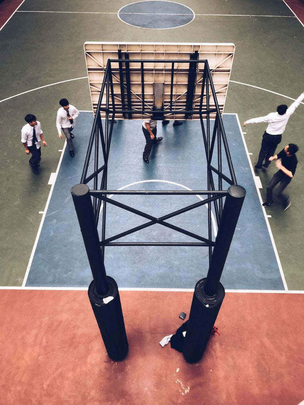 people standing under basketball hoop