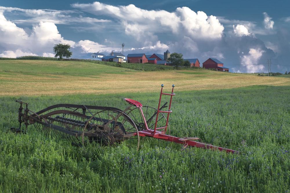 cultivator on grass field
