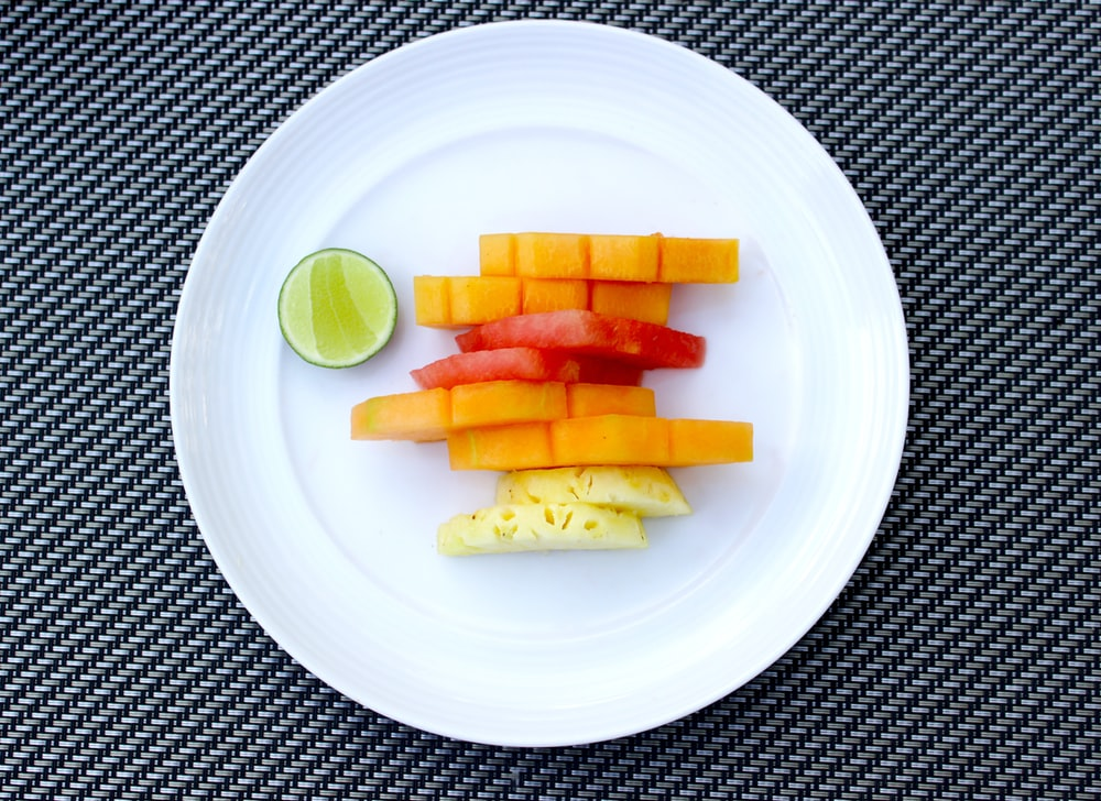 sliced of carrots and pineapple on plate