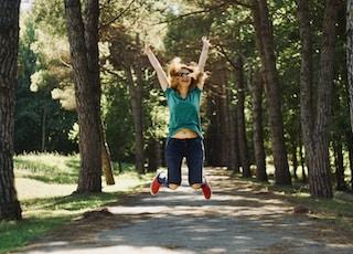 woman taking jump selfie