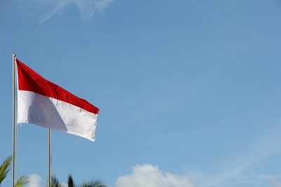 red and white flag under blue sky during daytime indonesia zoom background