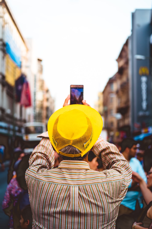 man taking picture near people at daytime