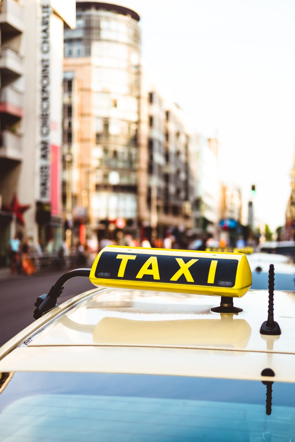 selective focus photo of yellow taxi LED signage