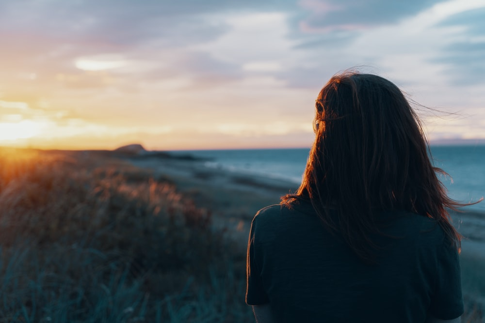 woman looking on body of water