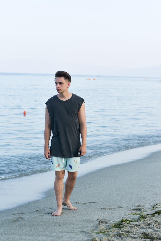 man walking on shore