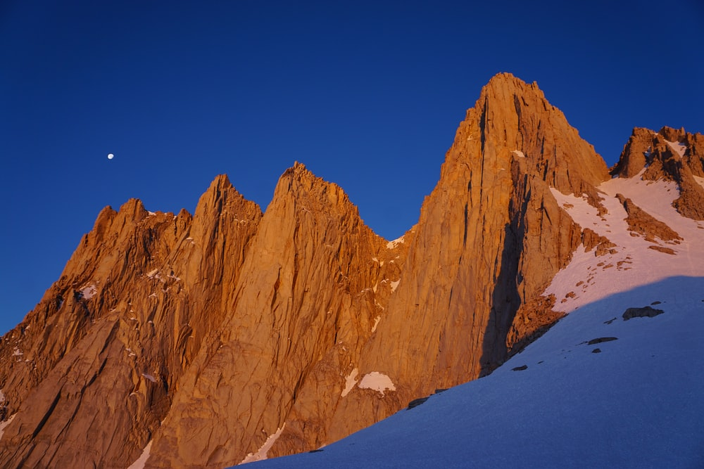 low-angle photography of brown rock mountain