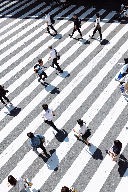 crowding people crossing on pedestrian lane
