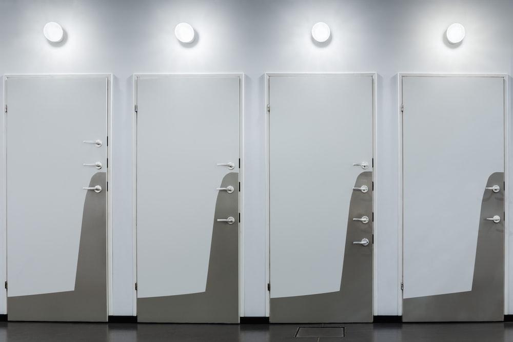 four white wooden doors