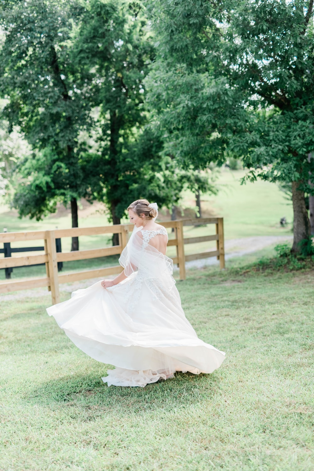 woman wearing white floral wedding gown