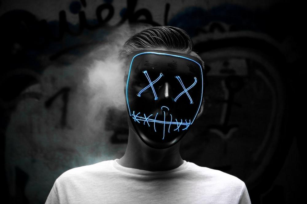 grayscale photo of man wearing mask