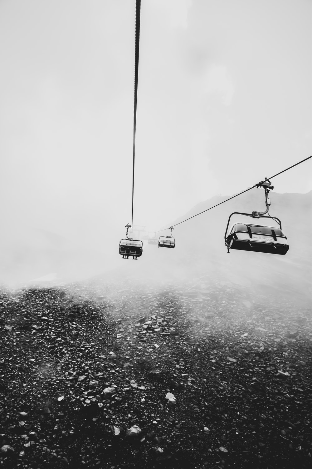 grayscale photography of cable cars