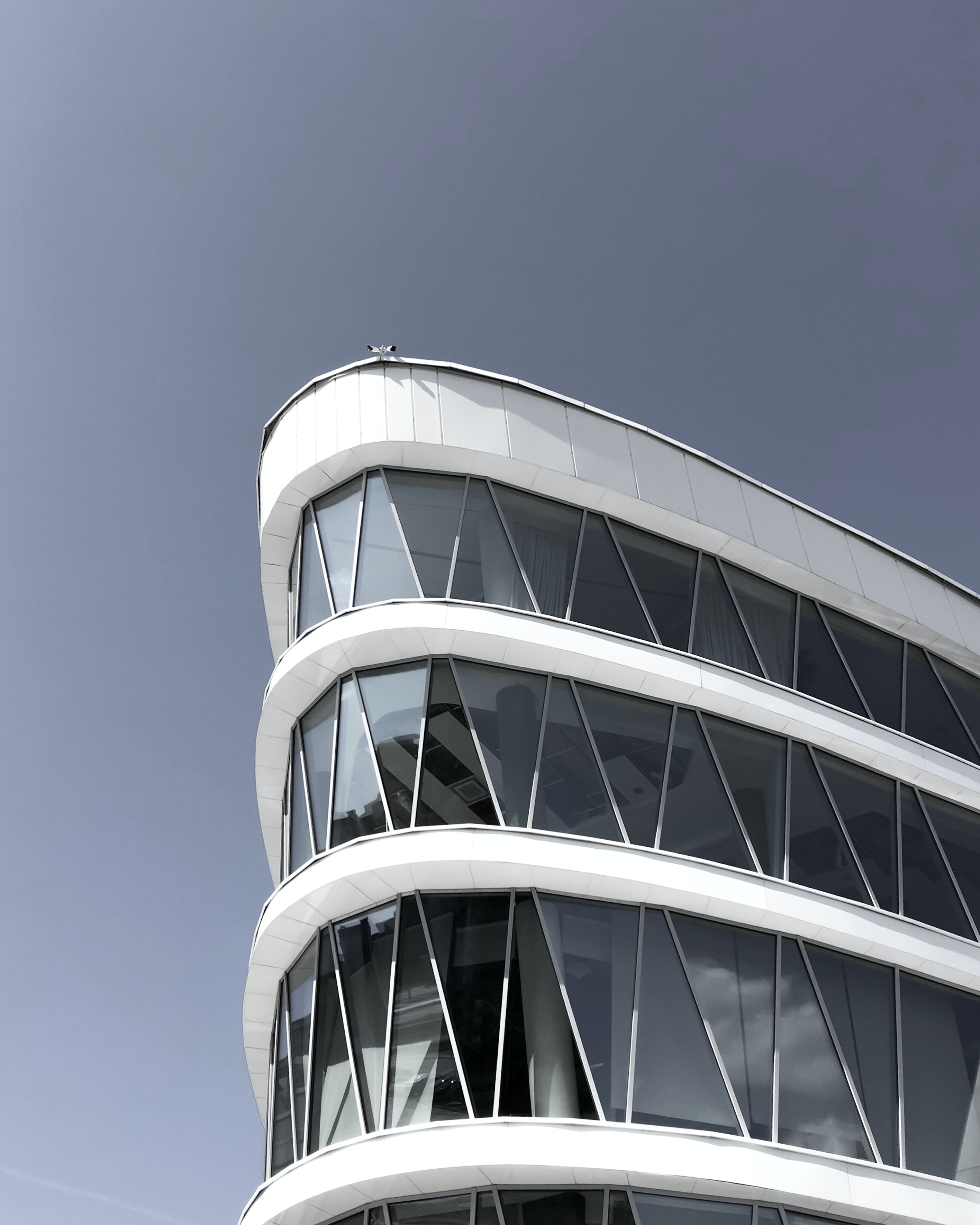 architectural photography of a white triangular building