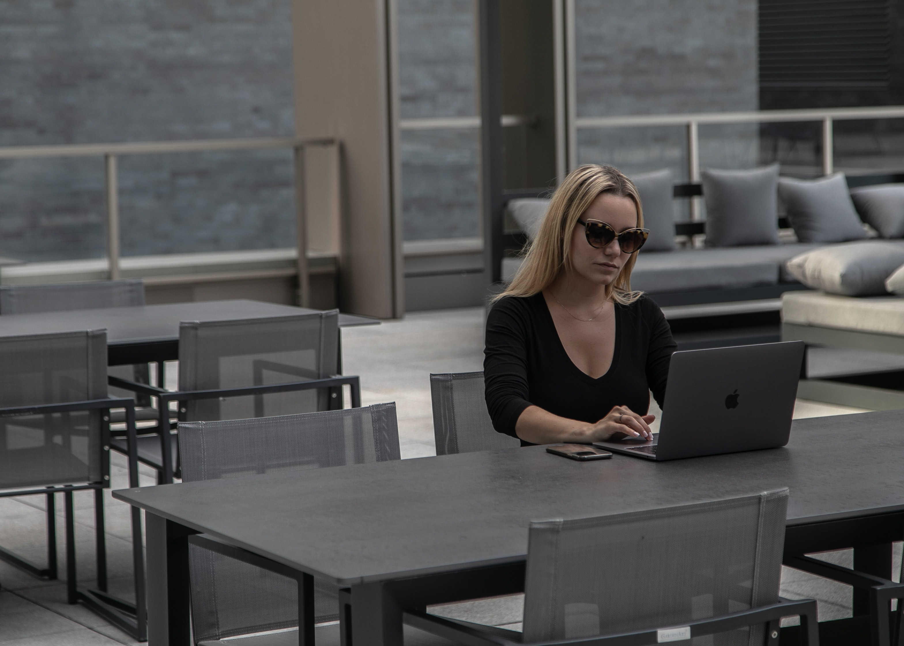 woman-working-on-computer-wearing-sunglasses