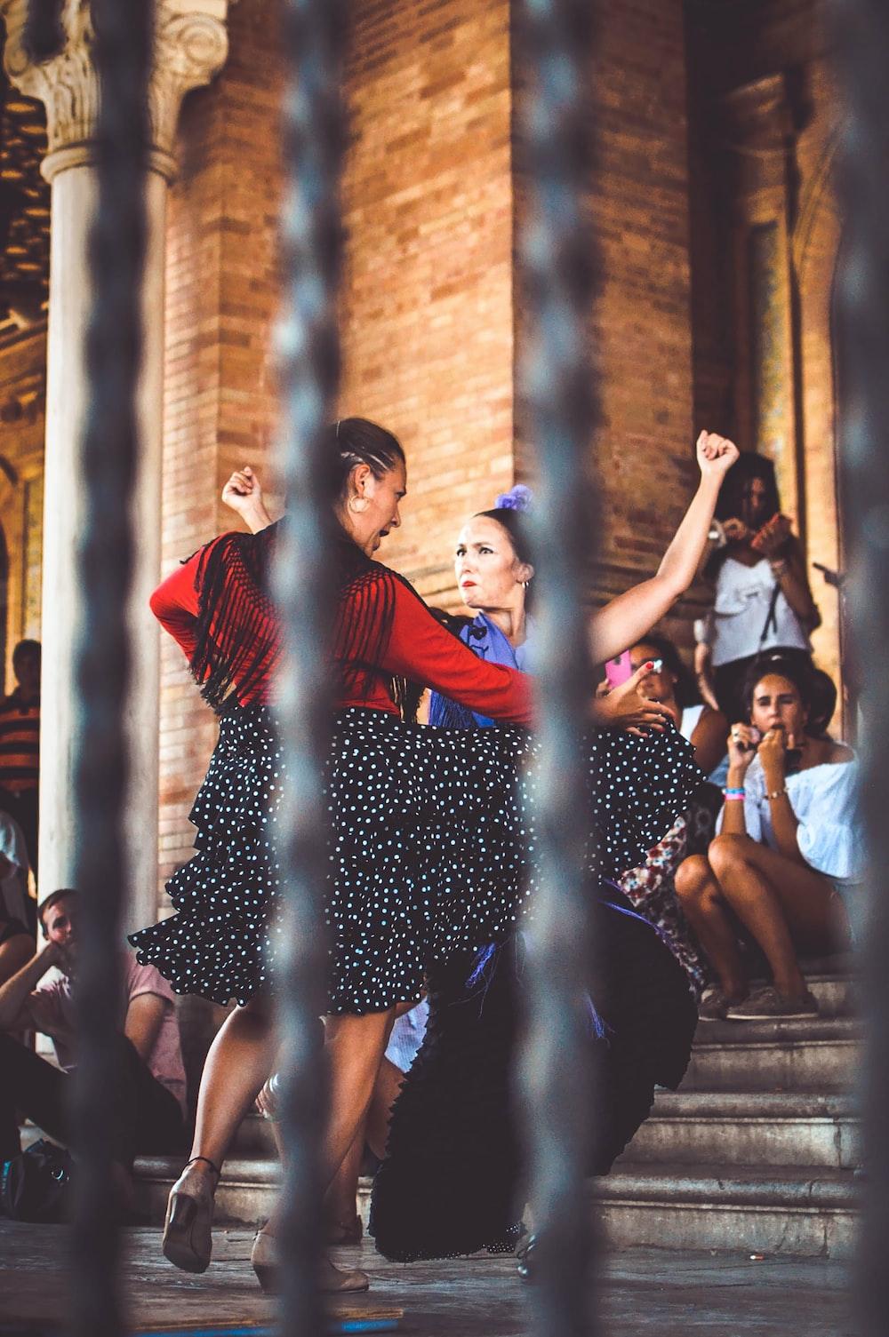 two women dancing outdoors