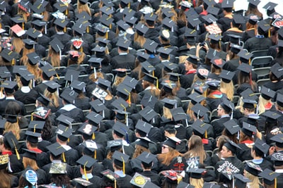 aerial view of graduates wearing hats graduation teams background