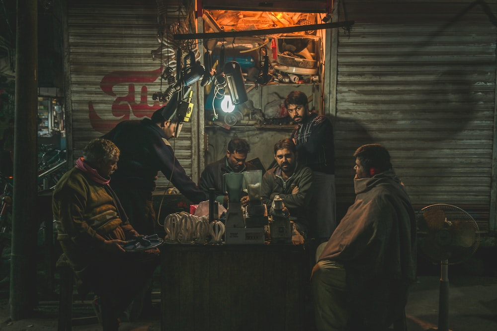 six men surround the table