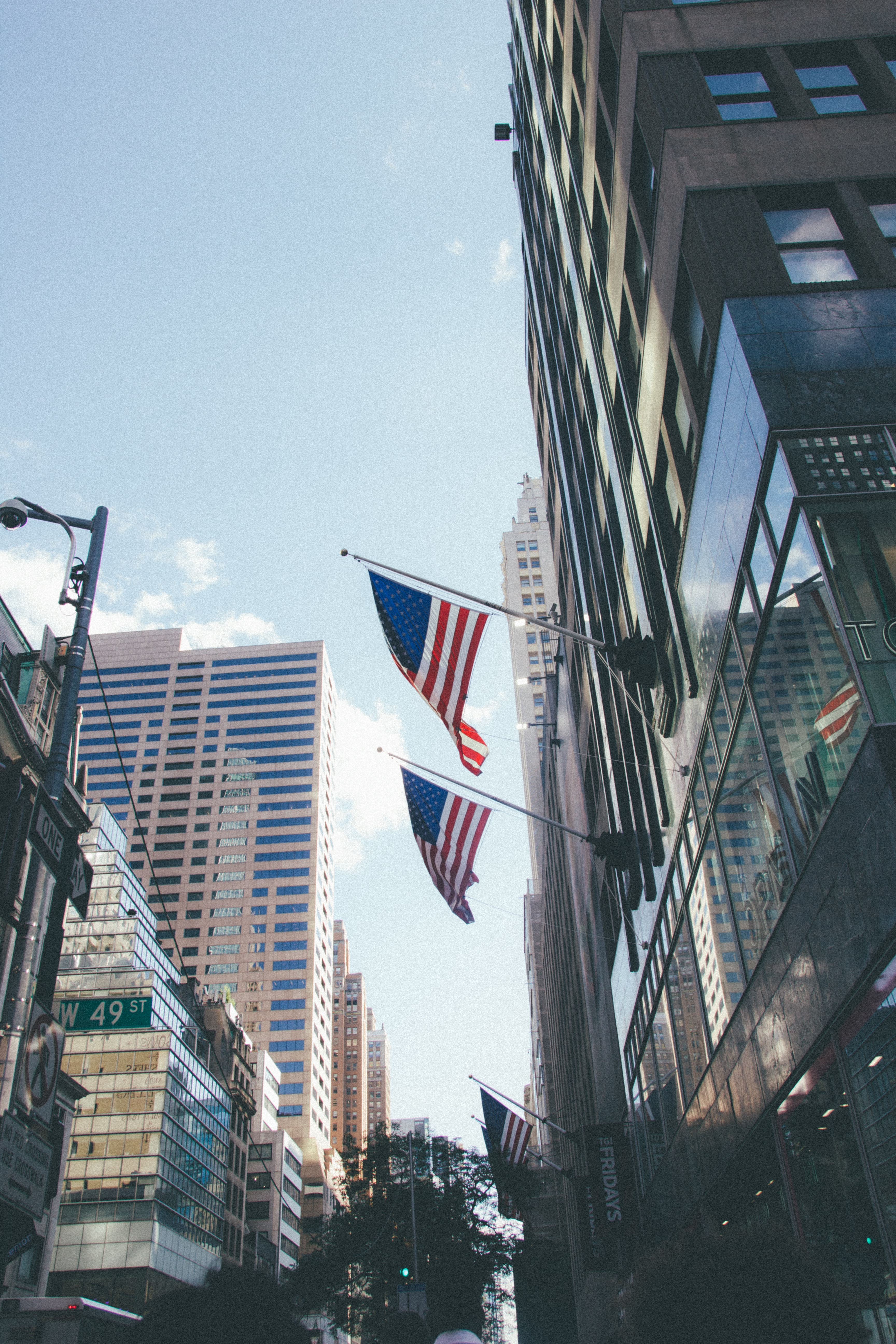 two USA flag mounted on building