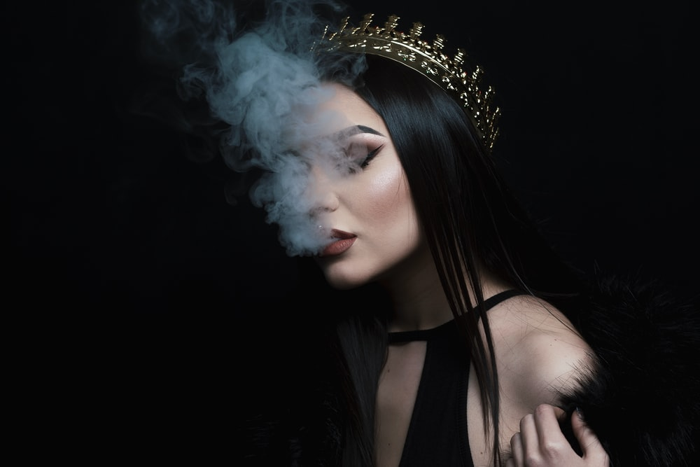smoke coming out from woman's mouth