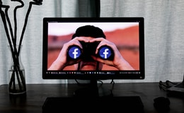 television showing man using binoculars