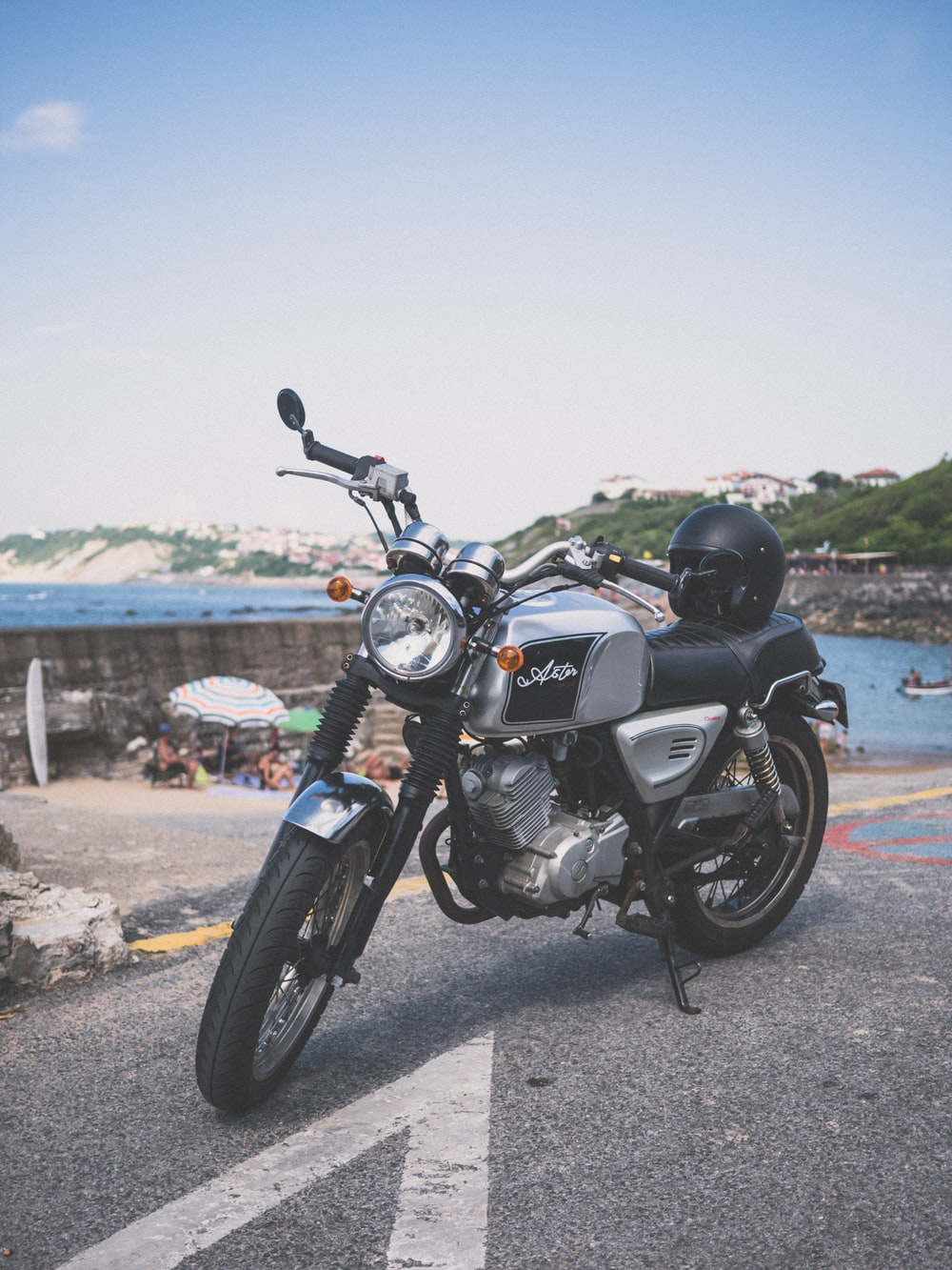 gray standard motorcycle parked far away from body of water