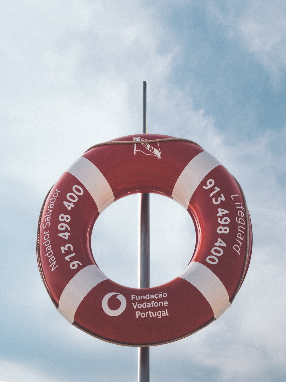 photo of red and white Vodafone inflatable floater
