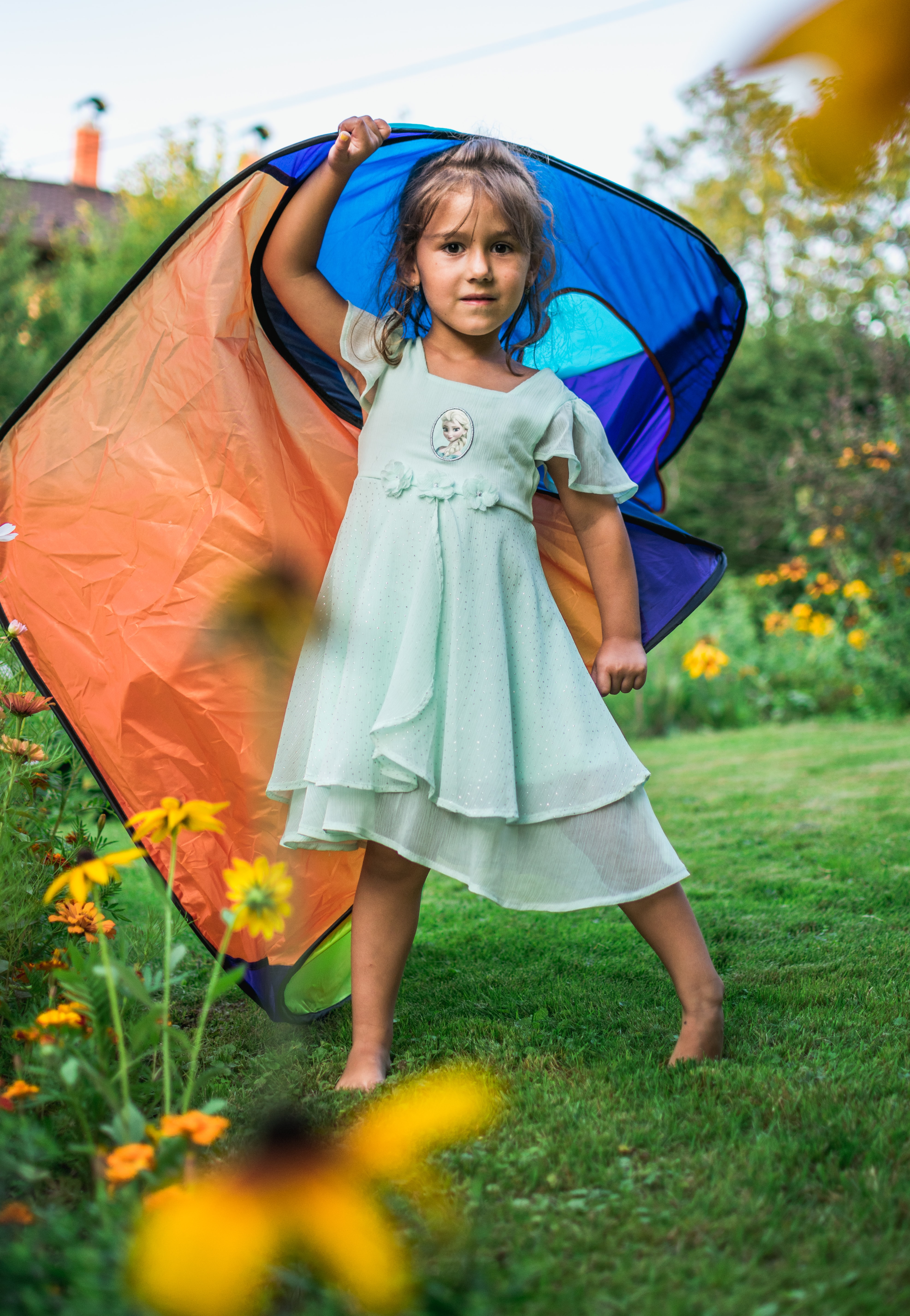 photo of girl holding tent