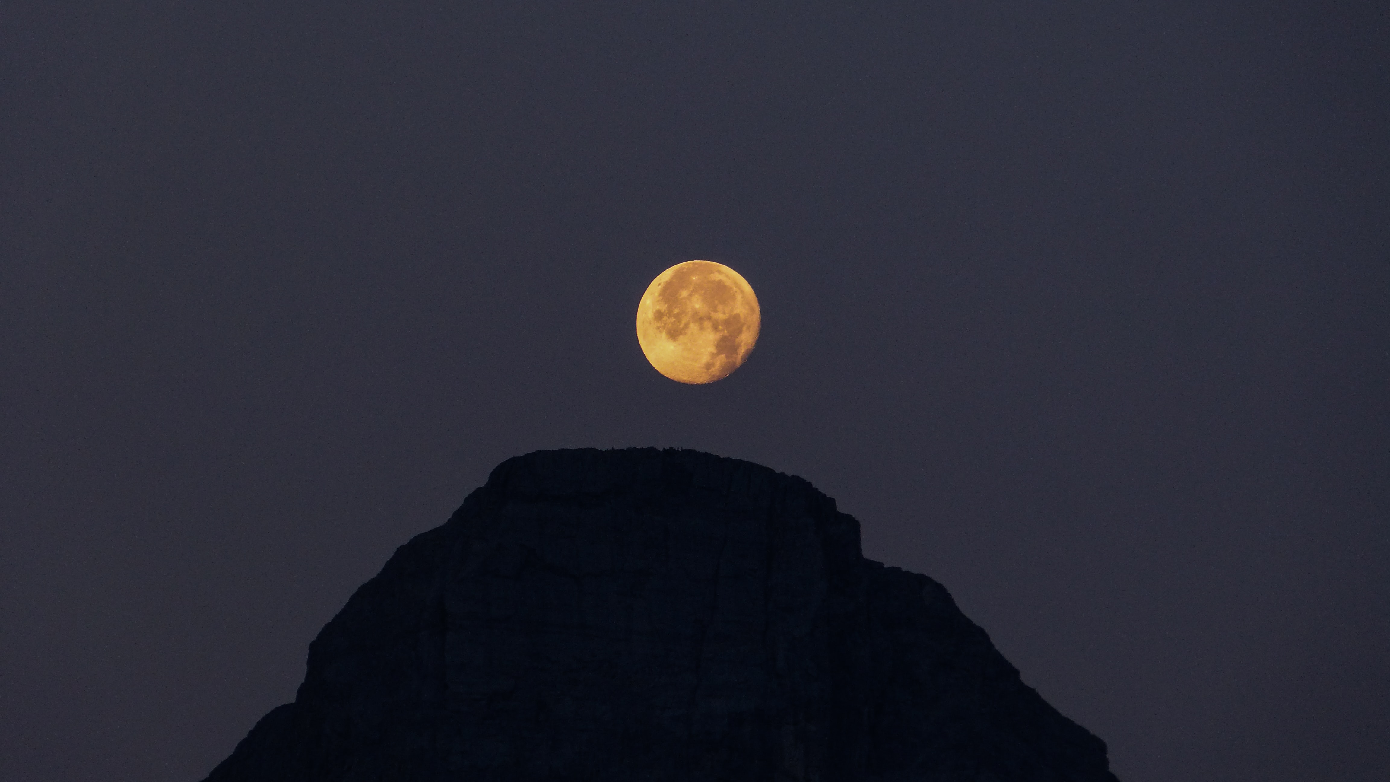 silhouette on mountain at night