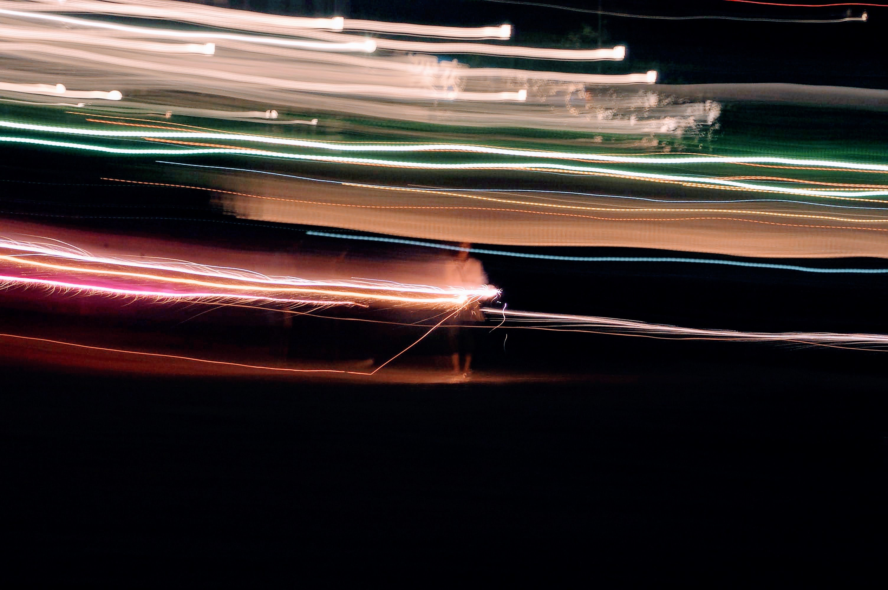 time-lapsed of white and red lights
