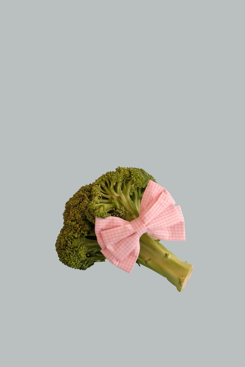 broccoli vegetable with pink ribbon