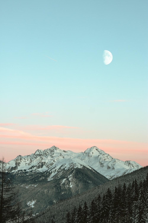 bird's eye view of mountain peaks under blue sky