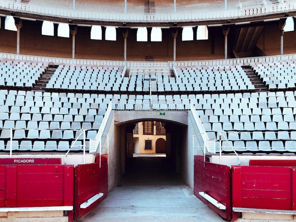 empty seats stadium taken during daytime