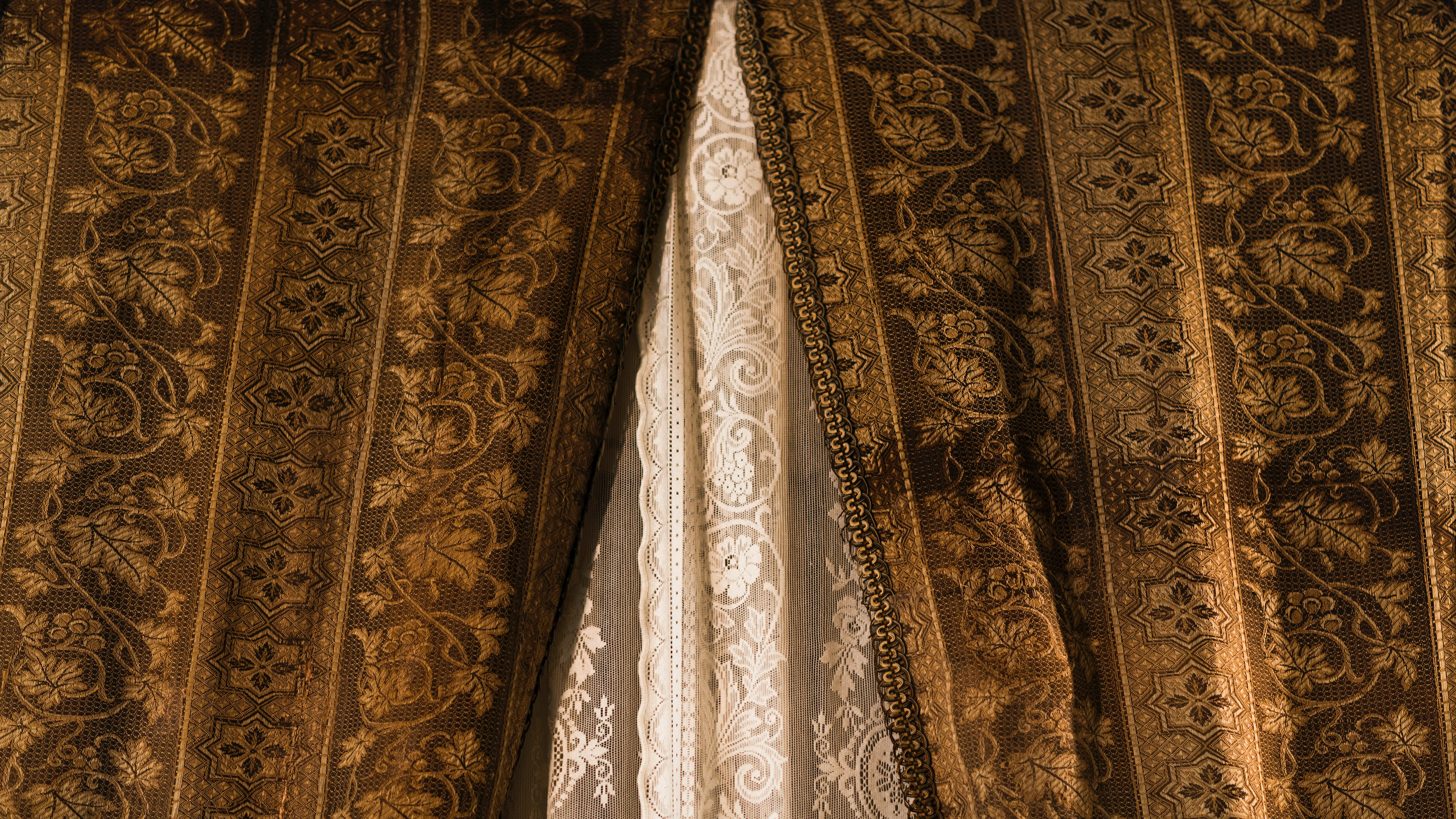 brown and black floral window curtain
