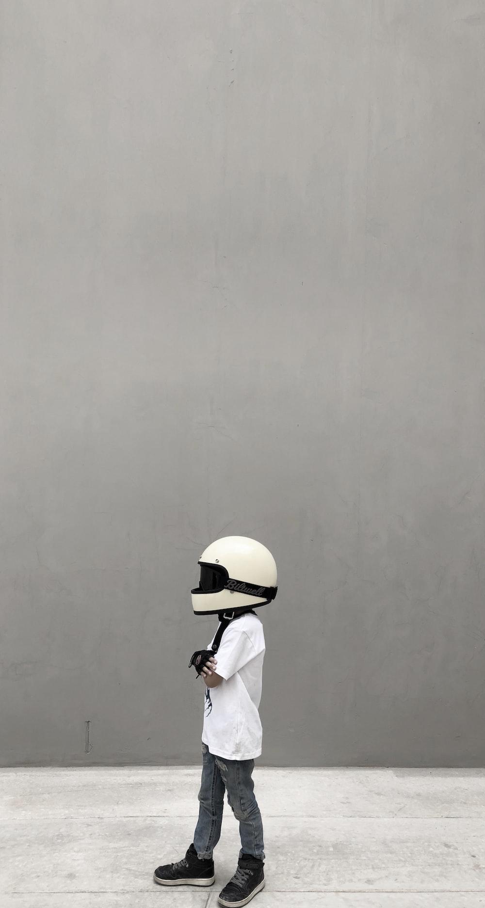 boy wearing full-face helmet