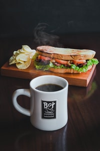 toasted bread with sliced tomatoes and coffee