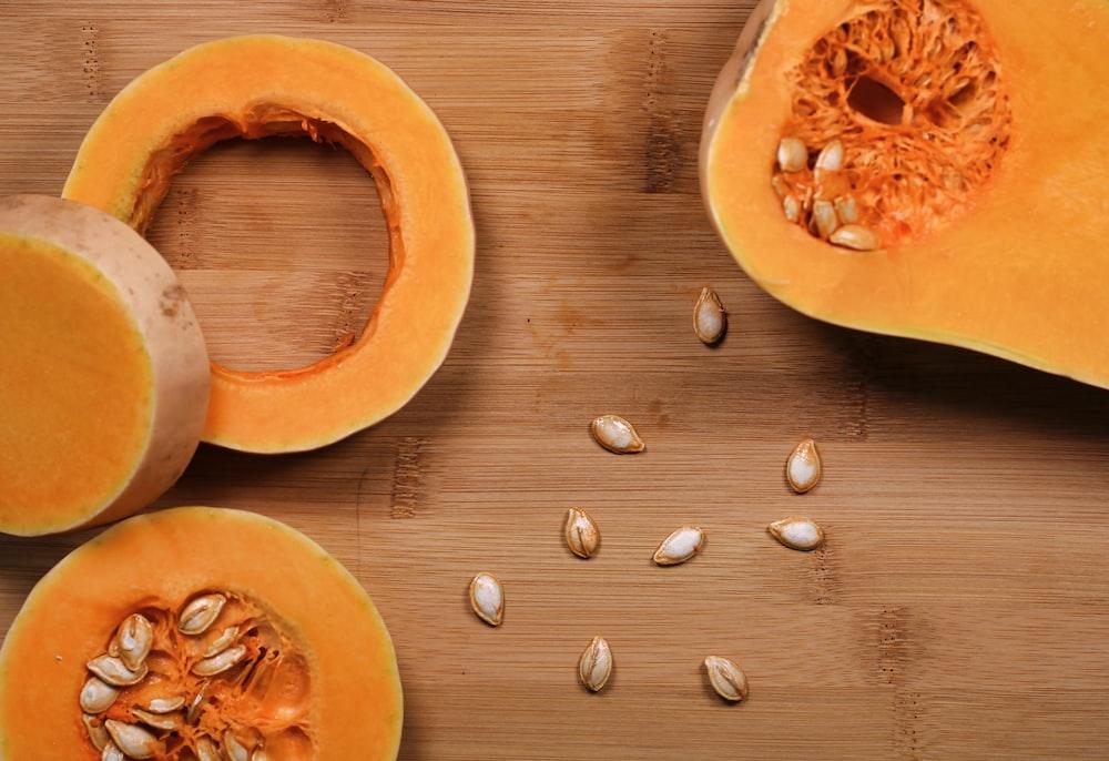 sliced pumpkin on brown wooden surface