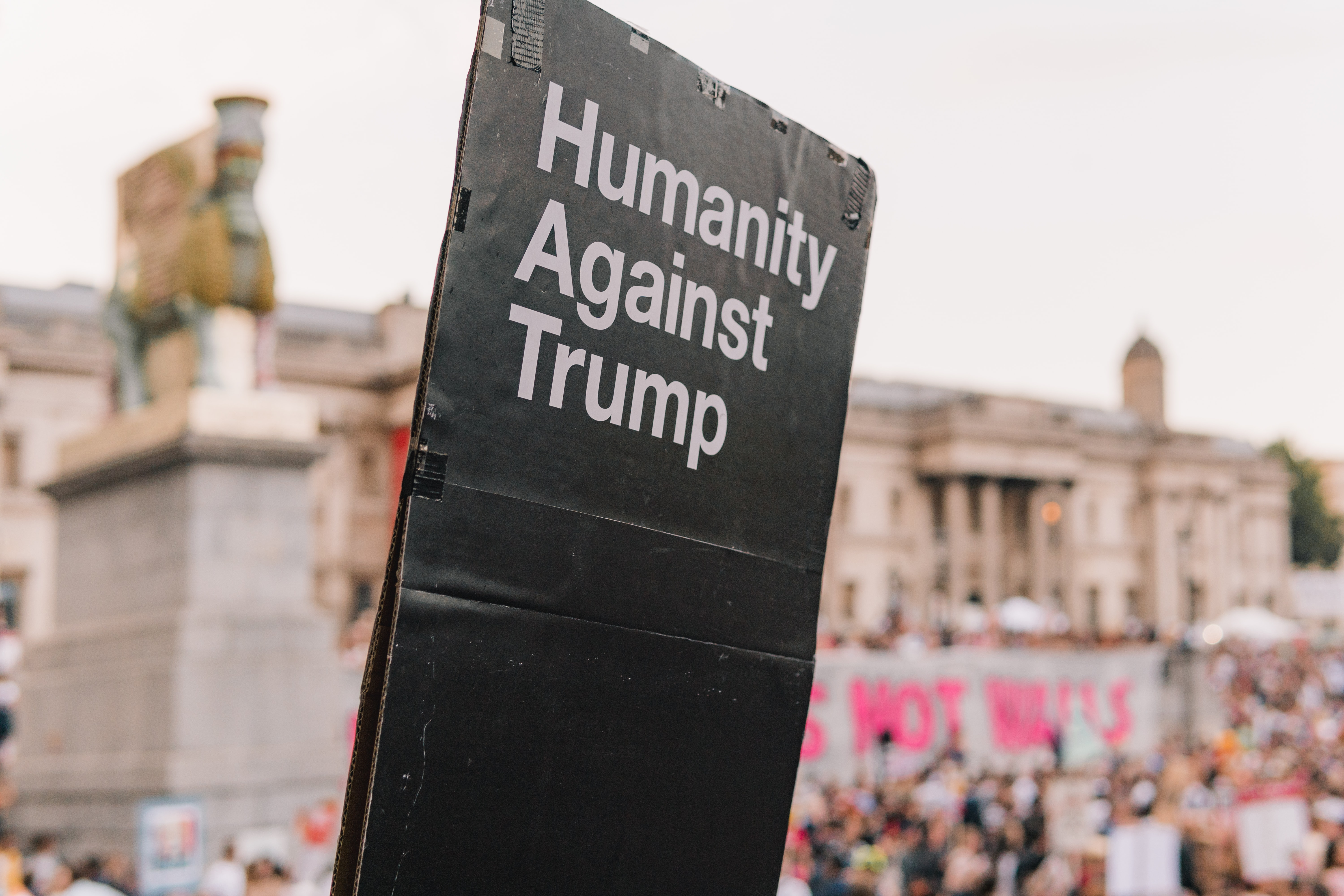 humanity against trump signage near buildings