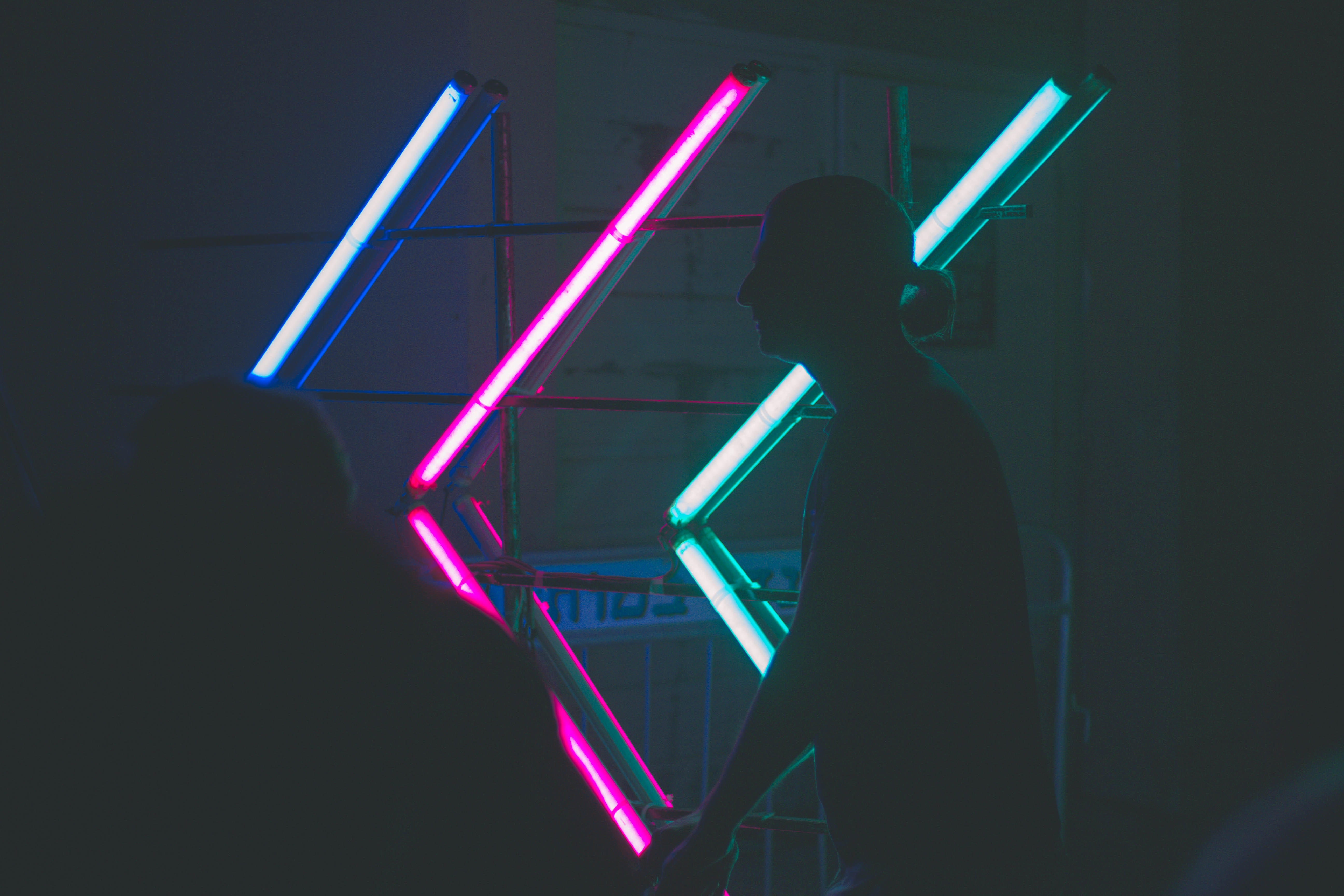 silhouette of man near neon lights