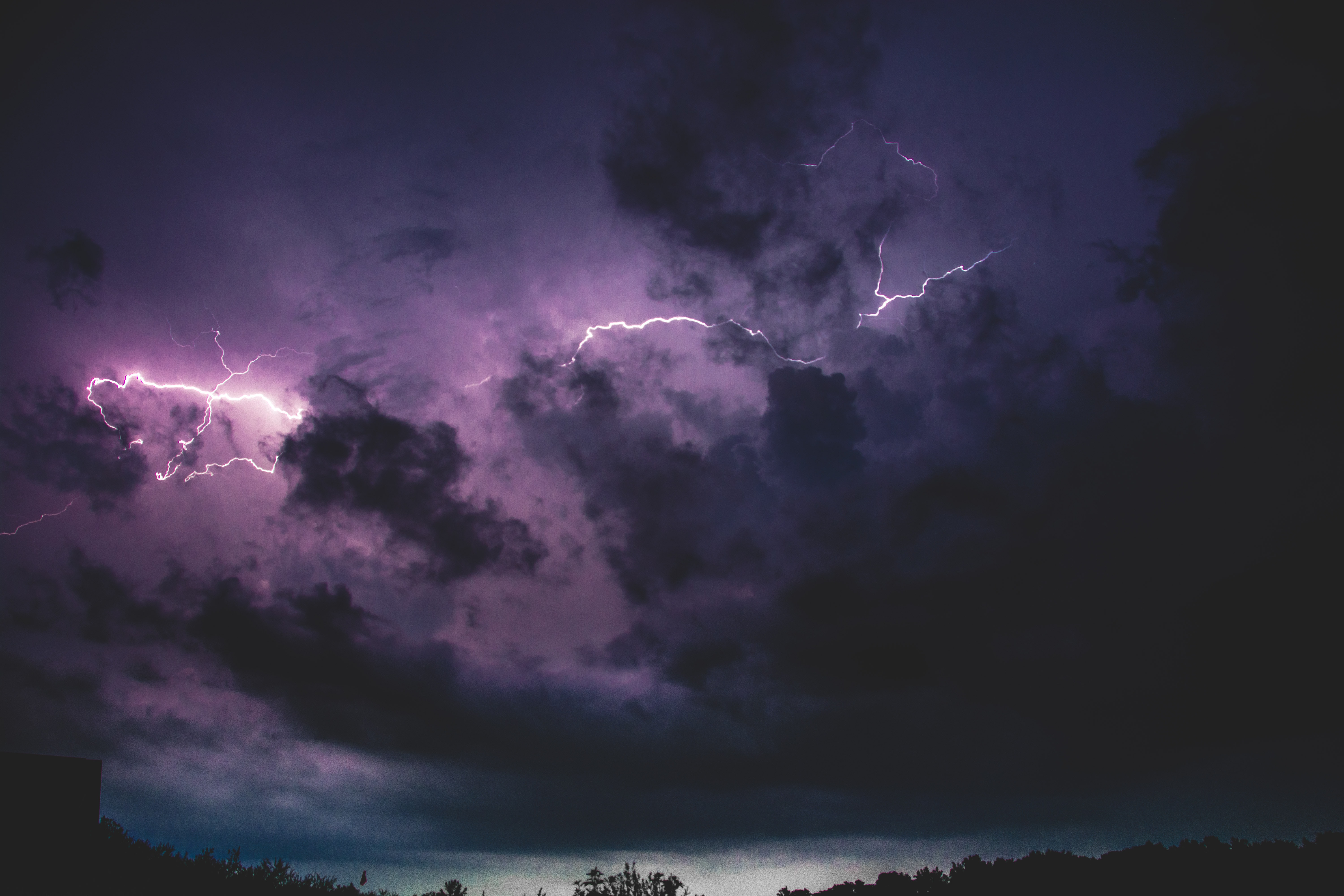 Lightning in Clouds at Night