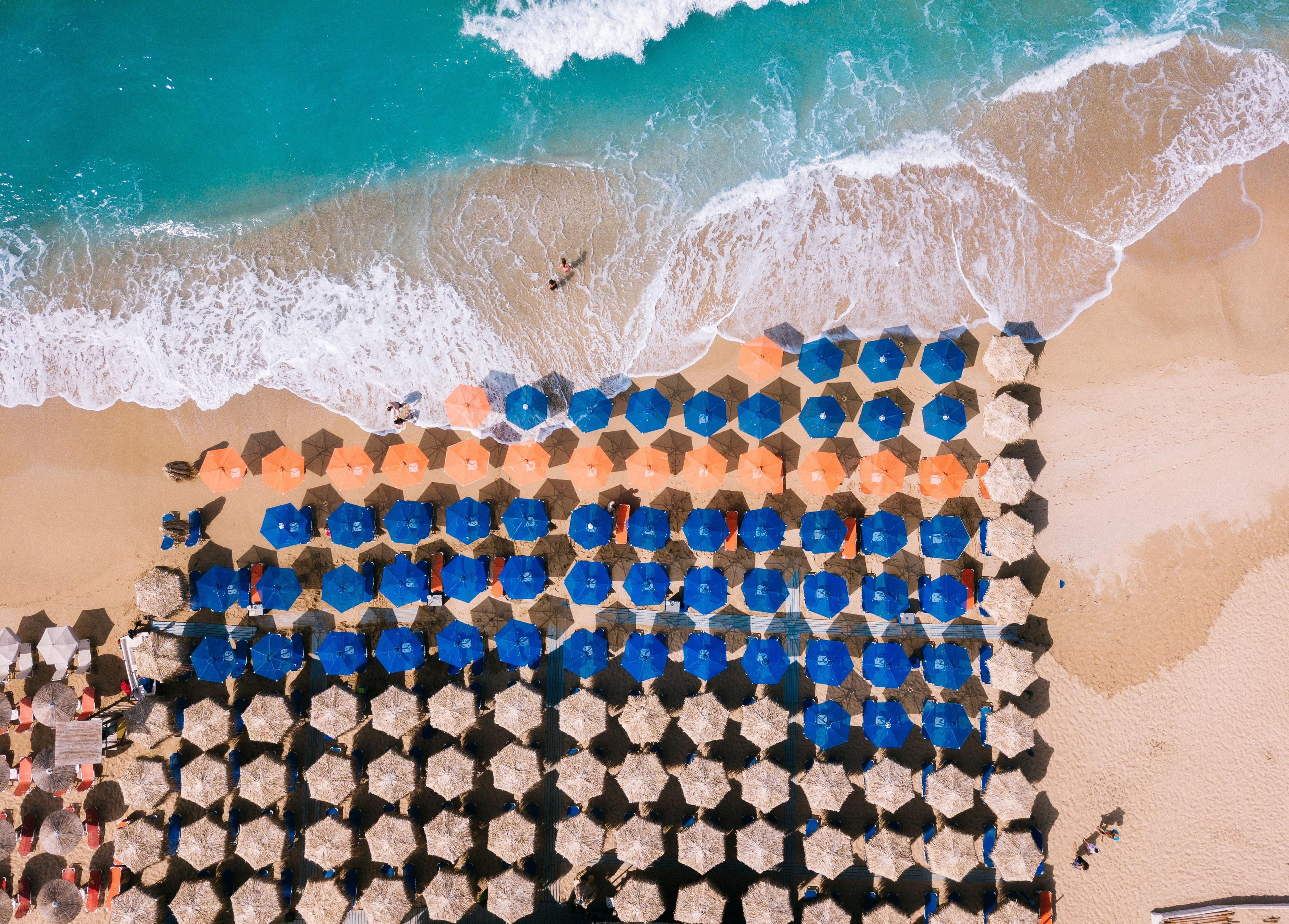 assorted-color parasol umbrellas on seashore