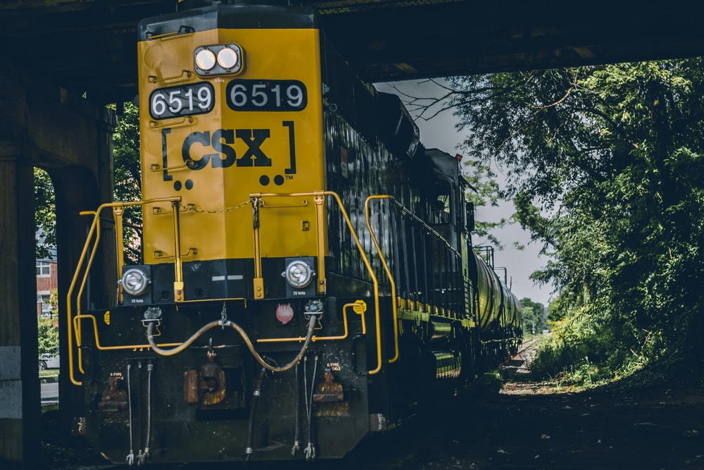yellow and black CSX train