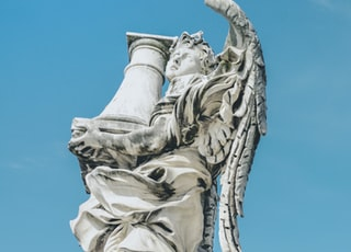angel holding pillar statue