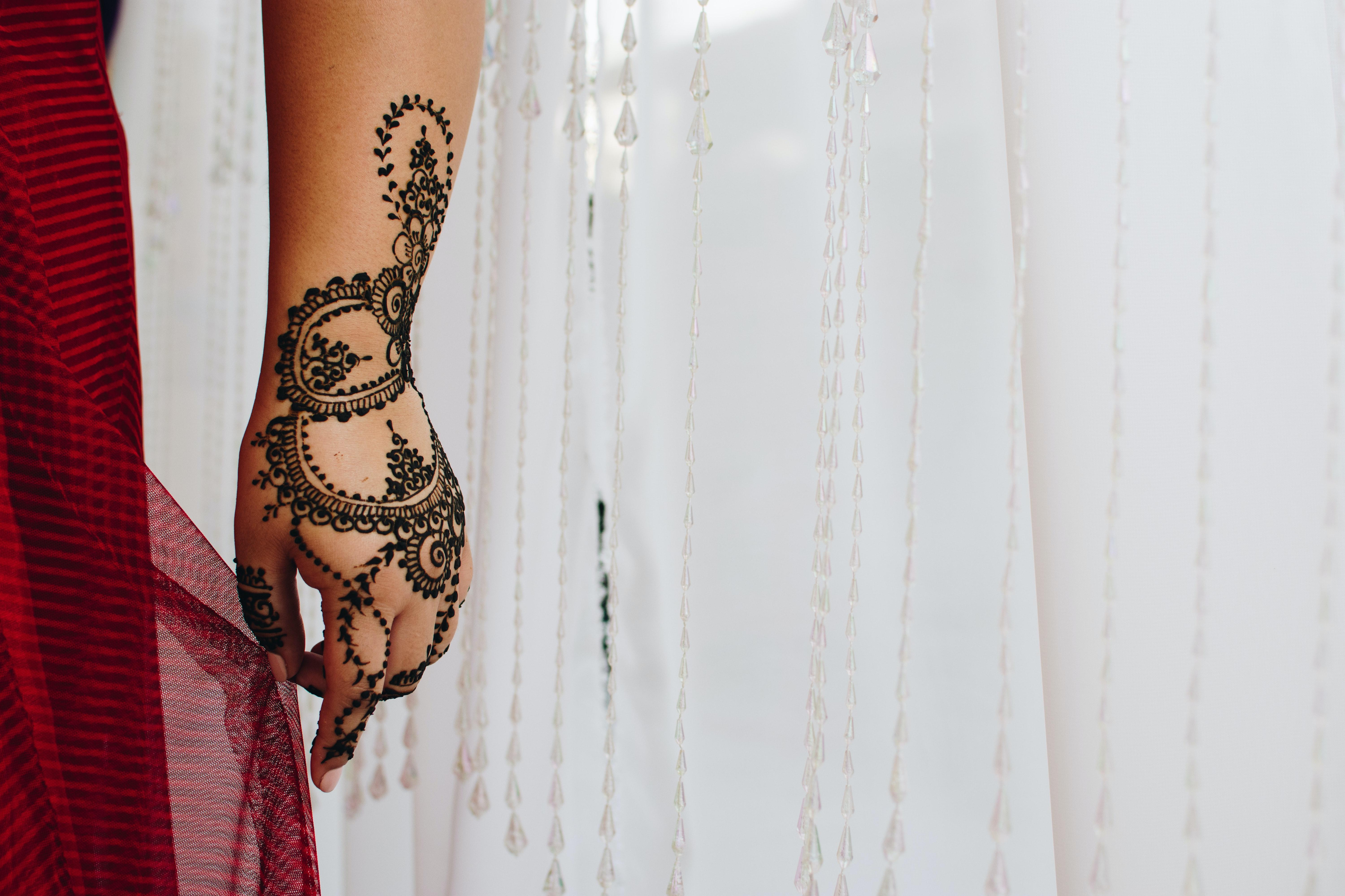 person showing bridal tattoo